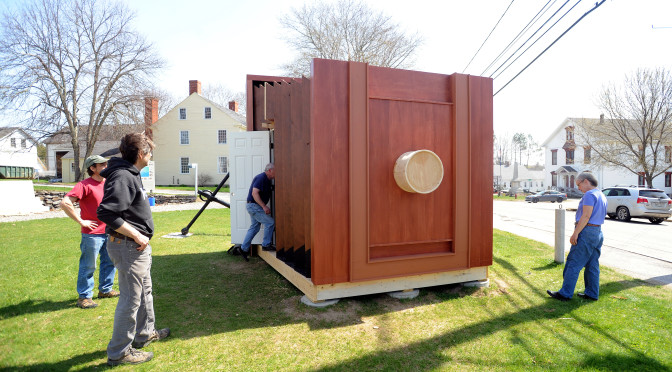 People check out the giant camera obsura constructed on at the Penobscot Marine Museum in Searsport.  When the camera is complete, several people will be able to go inside to experience how the image is projected inside real-life cameras.   Gabor Degre | BDN