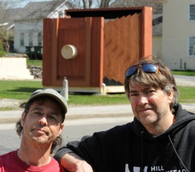 Kevin Johnson (right) and Matt Wheeler photo archivists at the Penobscot Marine Museum pose for a portrait with a giant camera obsura that is constructed on the lawn of the Penobscot Marine Museum in Searsport. Gabor Degre | BDN