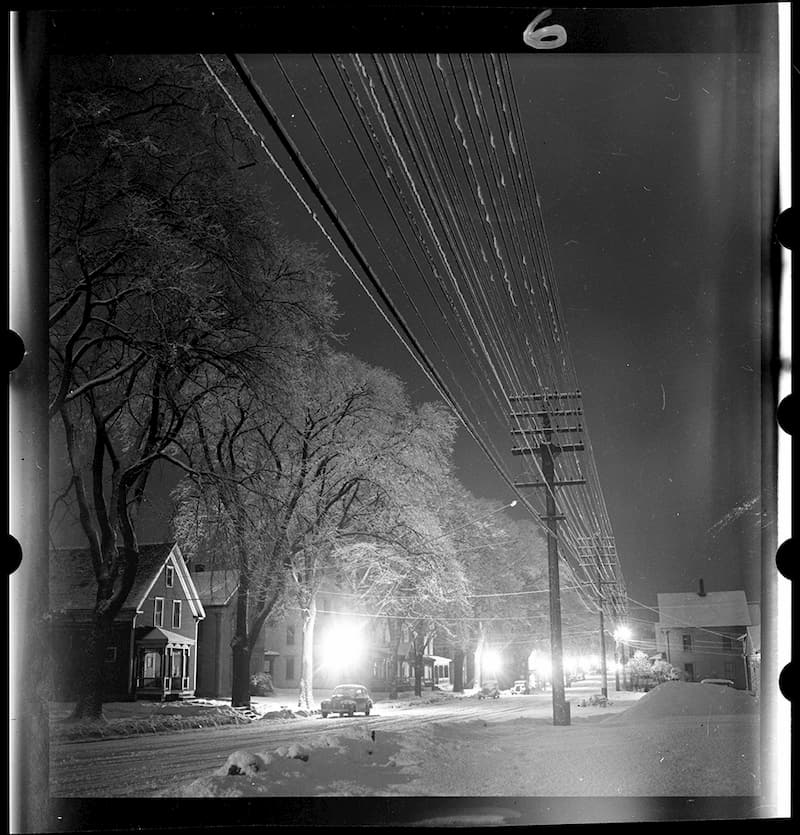 "Returning from eight months overseas, Kosti settled in the Dodge Mountain dwelling his father built when the family moved from Vermont. In the winter of 1949 he made photographs at night that are unique and surreal. He found the Park Street scene nearby in Rockland following a snow and ice storm. He later titled the image ""Winter lace"". It became one of a number selected as the essay: ""Winter Night Evokes Poets' Praises."" LIFE February 26, 1951 & Greatest Essays from LIFE Magazine, 1978"