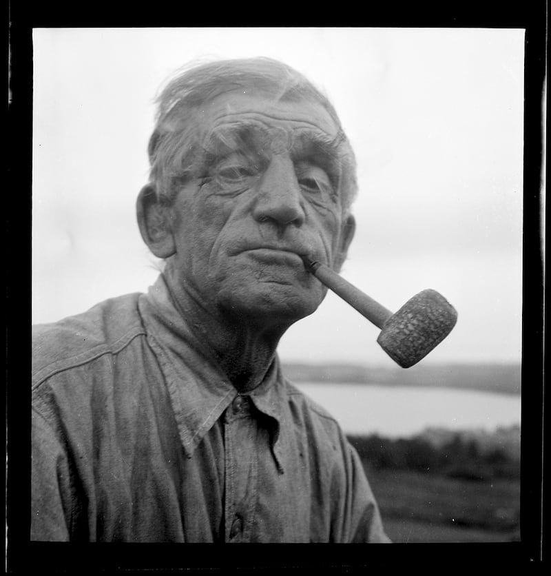 Maurice Stanley Powell, longtime family friend, farm hand and landowner was photographed often over the years. Kosti describes Powell as being a man of stories and witticisms. Rockland, ME, Circa 1950
