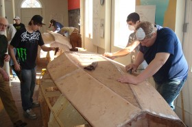 Searsport District High School Students working on a Shellback dinghy at PMM